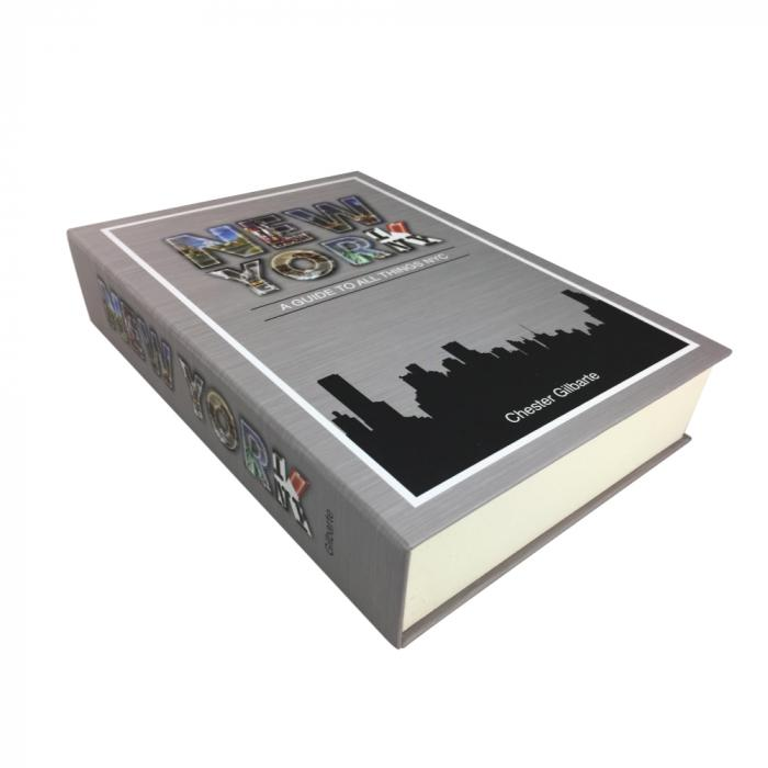 The Streetwise new york book safe with key to safely hide valuables shown in image how it looks when laid flat.