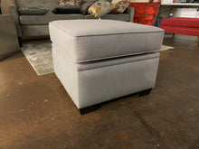 Storage Ottoman in Grey Upholstery