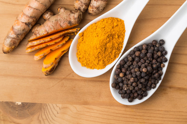 Turmeric roots and black pepper