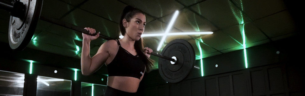 Female lifting weights in gym