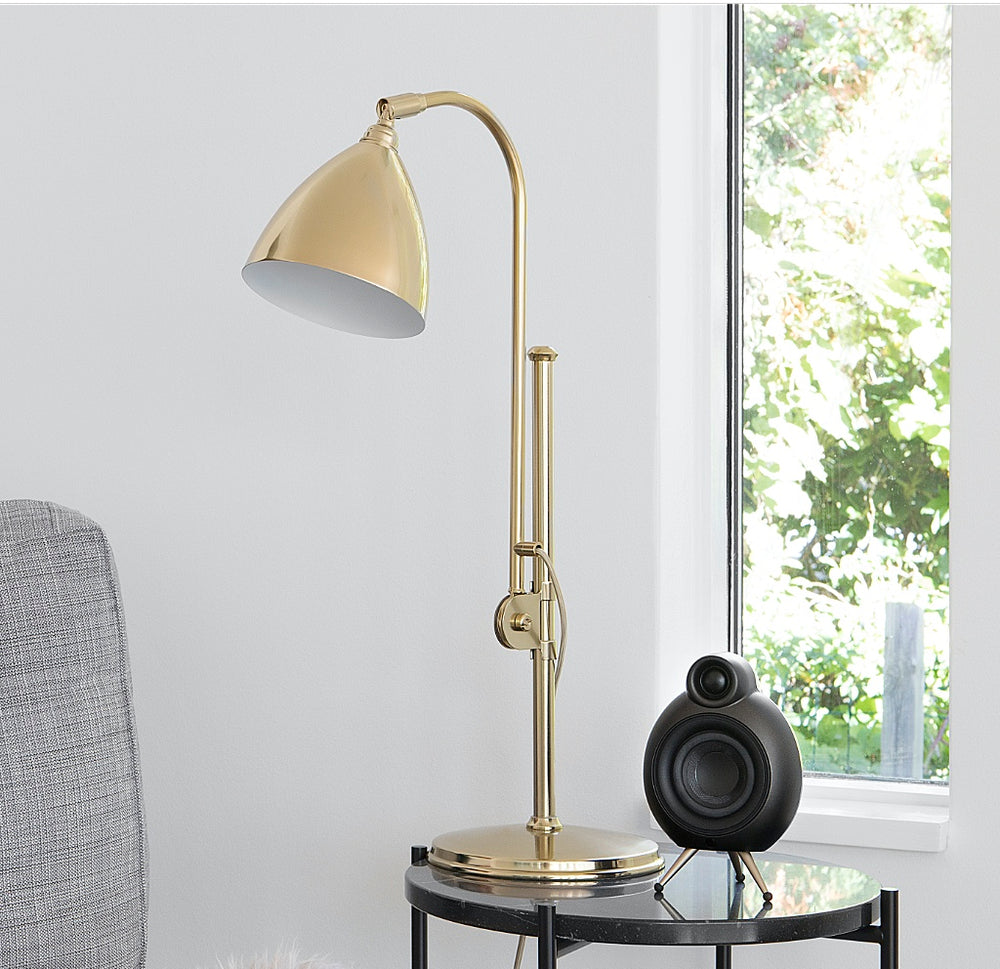 MicroPod matt black on coffee table with lamp
