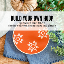 Load image into Gallery viewer, Build Your Own Hoop - 6 Inch Spiced Red Quilt Fabric in Embroidery Hoop with Hand Stamped Ivory Clay Ornament of Your Choice