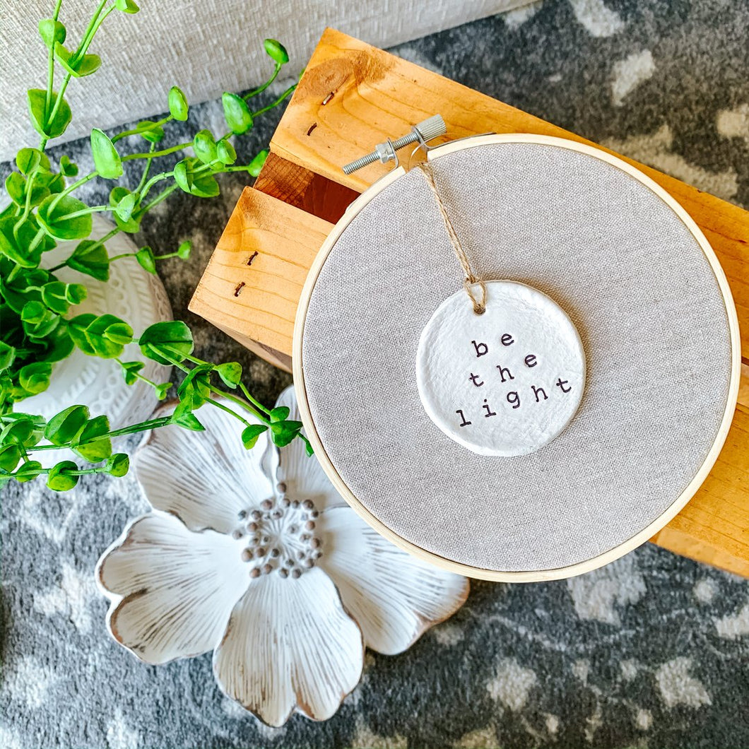 6 Inch Hoop with Natural Tan Linen Fabric and Hand Stamped Ivory Clay Circle 'Be the Light' Ornament