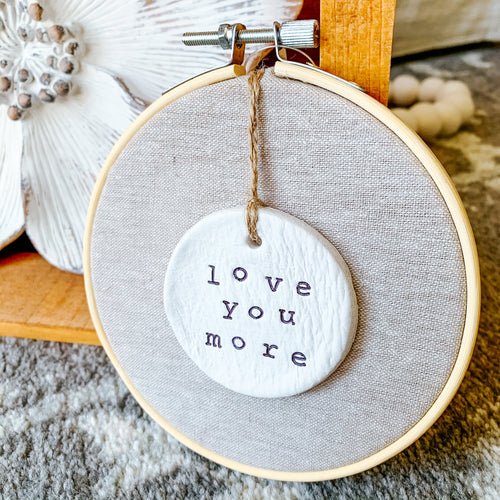 6 Inch Hoop with Natural Tan Linen Fabric and Hand Stamped Ivory Clay Circle 'Love You More' Ornament