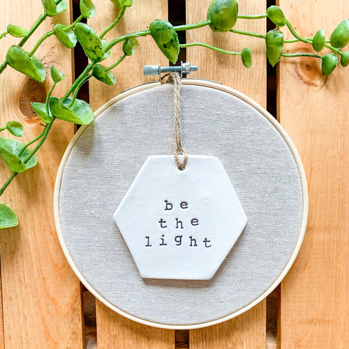6 Inch Hoop with Natural Tan Linen Fabric and Hand Stamped Ivory Clay Hexagon 'Be the Light' Ornament
