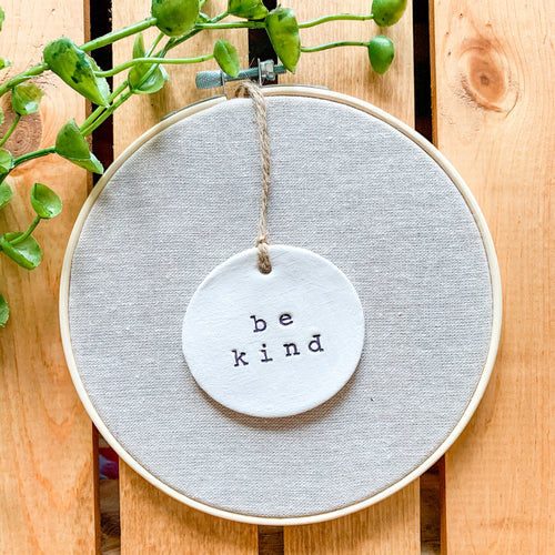6 Inch Hoop with Natural Tan Linen Fabric and Hand Stamped Ivory Clay Circle 'Be Kind' Ornament