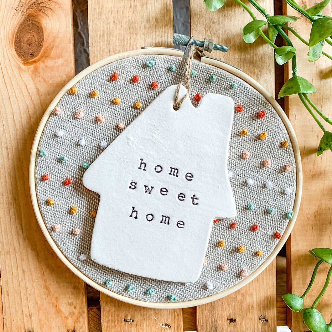 6 Inch Hoop with Natural Tan Linen Fabric, Hand Stitched French Knots, and Hand Stamped Ivory Clay House 'Home Sweet Home' Ornament