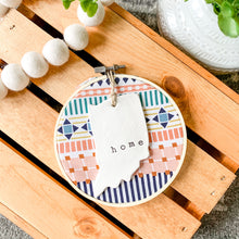 Load image into Gallery viewer, Build Your Own Hoop - 6 Inch Multicolor Geometric Fabric in Embroidery Hoop with Hand Stamped Ivory Clay Ornament of Your Choice