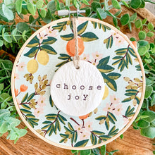 Load image into Gallery viewer, 6 Inch Hoop with Rifle Paper Co. Primavera Citrus Floral Mint Fabric and Hand Stamped Ivory Clay Circle 'Choose Joy' Ornament