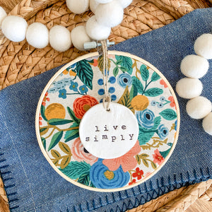 6 Inch Hoop with Rifle Paper Co. Garden Party Canvas Fabric and Hand Stamped Ivory Clay Circle 'Live Simply' Ornament