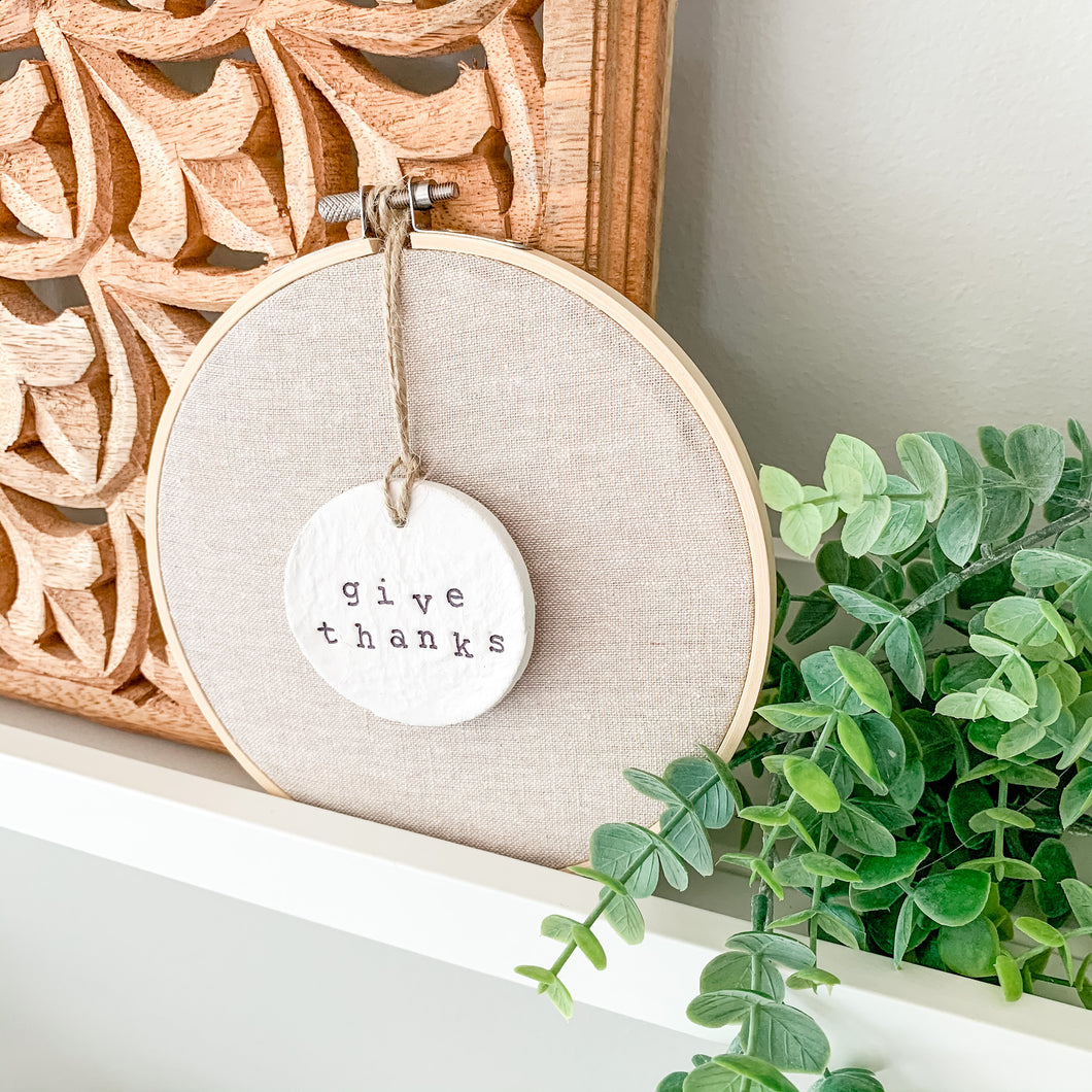 6 Inch Hoop with Natural Tan Linen Fabric and Hand Stamped Ivory Clay Circle 'Give Thanks' Ornament