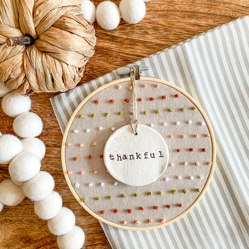 6 Inch Hoop with Hand Stitched French Knots on Natural Linen Fabric and Hand Stamped Ivory Clay Circle 'Thankful' Ornament