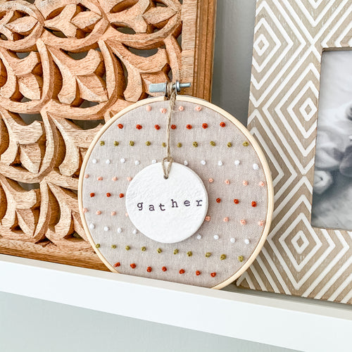 6 Inch Hoop with Hand Stitched French Knots on Natural Linen Fabric and Hand Stamped Ivory Clay Circle 'Gather' Ornament