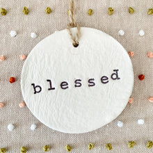 Load image into Gallery viewer, 6 Inch Hoop with Hand Stitched French Knots on Natural Linen Fabric and Hand Stamped Ivory Clay Circle 'Blessed' Ornament