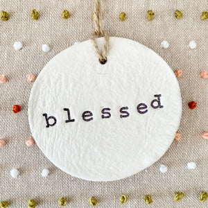 6 Inch Hoop with Hand Stitched French Knots on Natural Linen Fabric and Hand Stamped Ivory Clay Circle 'Blessed' Ornament