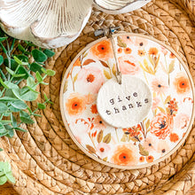 Load image into Gallery viewer, 6 Inch Hoop with Fall Garden Fabric and Hand Stamped Ivory Clay Circle 'Give Thanks' Ornament