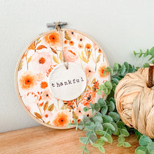 Load image into Gallery viewer, 6 Inch Hoop with Fall Garden Fabric and Hand Stamped Ivory Clay Circle 'Thankful' Ornament