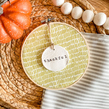 Load image into Gallery viewer, 6 Inch Hoop with Green Dash Fabric and Hand Stamped Ivory Clay Circle 'Thankful' Ornament