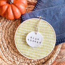 Load image into Gallery viewer, 6 Inch Hoop with Green Dash Fabric and Hand Stamped Ivory Clay Circle 'Give Thanks' Ornament