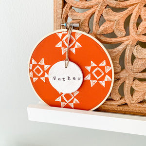 6 Inch Hoop with Spiced Red Quilt Fabric and Hand Stamped Ivory Clay Circle 'Gather' Ornament