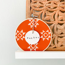 Load image into Gallery viewer, 6 Inch Hoop with Spiced Red Quilt Fabric and Hand Stamped Ivory Clay Circle 'Gather' Ornament
