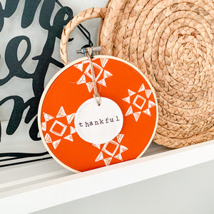 6 Inch Hoop with Spiced Red Quilt Fabric and Hand Stamped Ivory Clay Circle 'Thankful' Ornament
