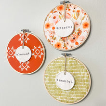Load image into Gallery viewer, 3 Hoop Set - 6 Inch Hoops with Fall Garden, Spiced Red Quilt, and Green Dash Fabric and Hand Stamped Ivory Clay Circle Ornaments