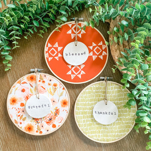 3 Hoop Set - 6 Inch Hoops with Fall Garden, Spiced Red Quilt, and Green Dash Fabric and Hand Stamped Ivory Clay Circle Ornaments