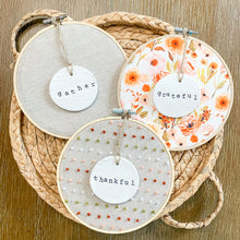 Load image into Gallery viewer, 3 Hoop Set - 6 Inch Hoops with Fall Garden and Natural Tan Linen Fabric and Hand Stamped Ivory Clay Circle Ornaments