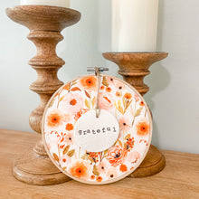 Load image into Gallery viewer, 6 Inch Hoop with Fall Garden Fabric and Hand Stamped Ivory Clay Circle 'Grateful' Ornament