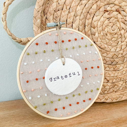 6 Inch Hoop with Hand Stitched French Knots on Natural Linen Fabric and Hand Stamped Ivory Clay Circle 'Grateful' Ornament