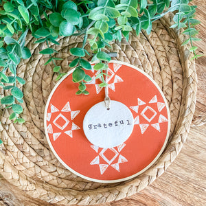 6 Inch Hoop with Spiced Red Quilt Fabric and Hand Stamped Ivory Clay Circle 'Grateful' Ornament