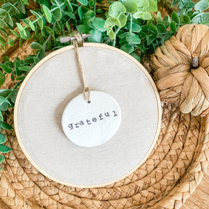 6 Inch Hoop with Natural Tan Linen Fabric and Hand Stamped Ivory Clay Circle 'Grateful' Ornament