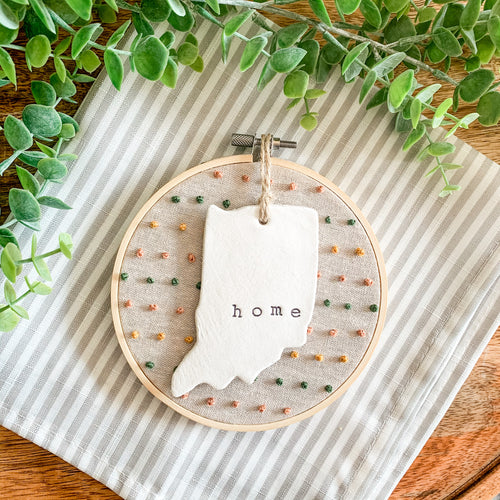 5 Inch Hoop with Natural Tan Linen Fabric, Hand Stitched French Knots, and Hand Stamped Ivory Clay Indiana 'Home' Ornament