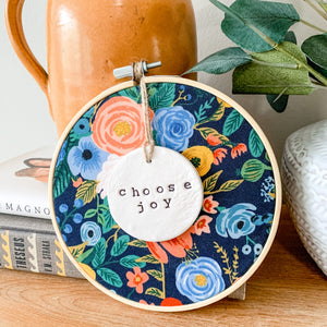 6 Inch Hoop with Rifle Paper Co. Navy Wildwood Garden Party Fabric and Hand Stamped Ivory Clay Circle 'Choose Joy' Ornament