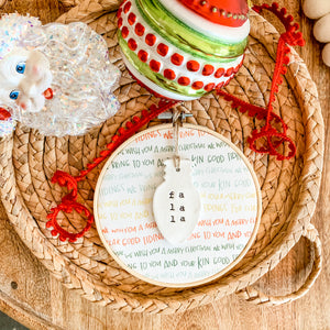 6 Inch Hoop with Good Tidings Fabric and Hand Stamped Ivory Clay Bulb 'Fa La La' Ornament