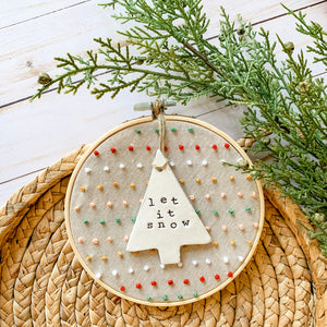 6 Inch Hoop with Hand Stitched French Knots on Natural Linen Fabric and Hand Stamped Ivory Clay Tree 'Let it Snow' Ornament