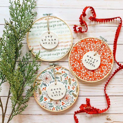 3 Hoop Set - 6 Inch Hoops with Winter Floral, Cardinal Red Frosty Floral, and Good Tidings Fabric and Hand Stamped Ivory Clay Circle Ornaments
