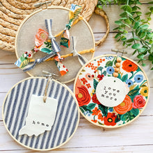 Load image into Gallery viewer, 6 Inch Hoop with Navy Ticking Stripe Fabric and Hand Stamped Ivory Clay Indiana 'Home' Ornament