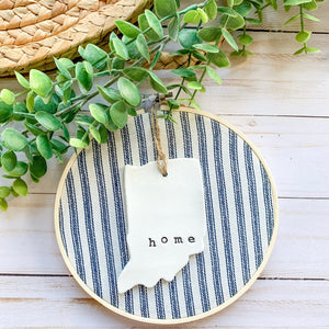 6 Inch Hoop with Navy Ticking Stripe Fabric and Hand Stamped Ivory Clay Indiana 'Home' Ornament