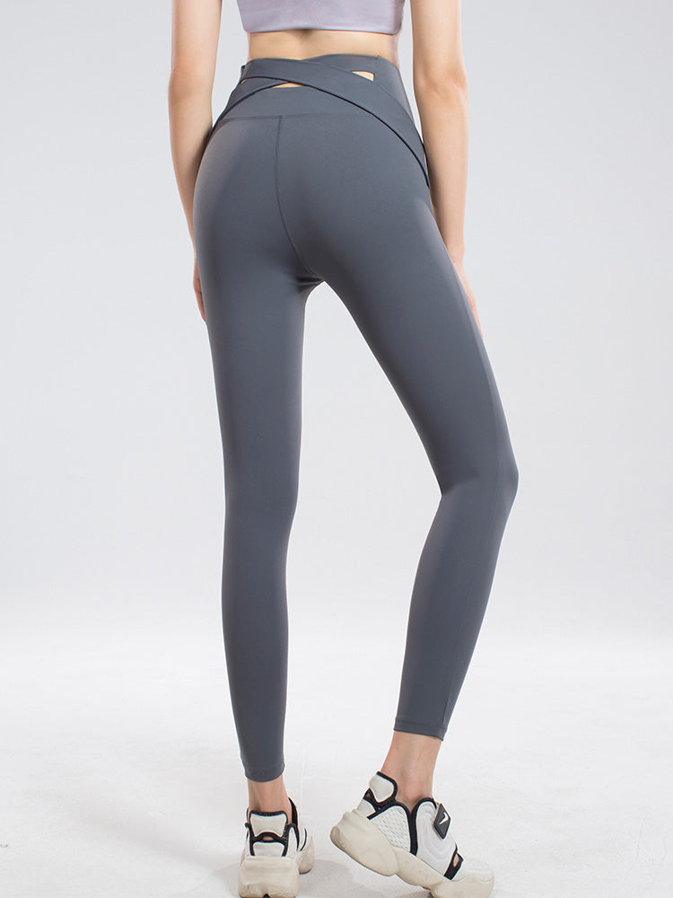 Crossed belt hip-up sports tights