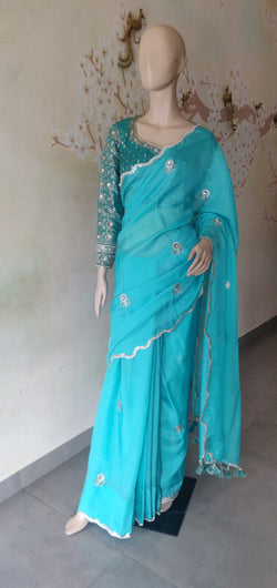Aqua uneven edge saree with brocade blouse