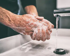 Man Washing His Hands With Soapy Water