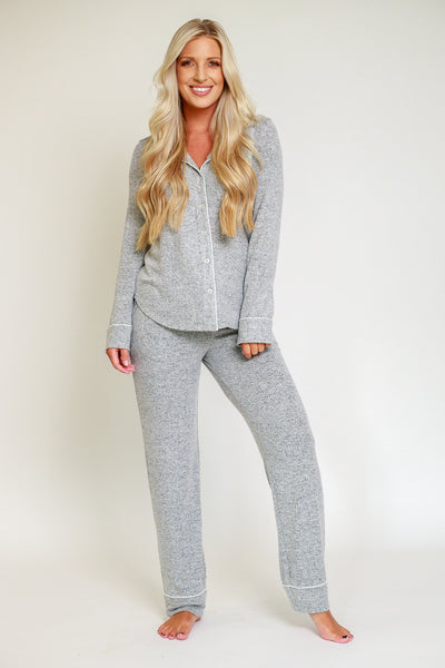 Grey pajama set with a straight pants in a comfortable fabric long sleeve button down and long