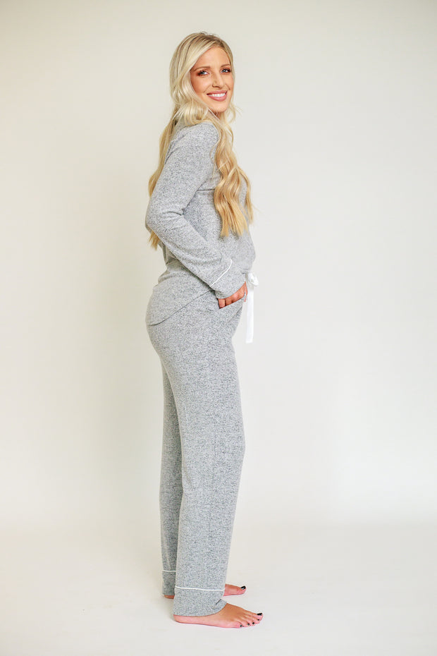 Side view of grey long sleeve and long pant pajama set with contrast piping