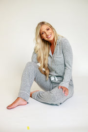 Woman sitting in grey cozy pajama set