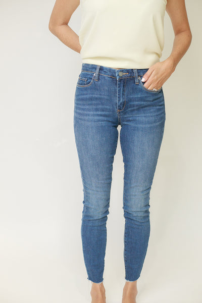Raw ankle hem mid rise skinny jeans in medium wash