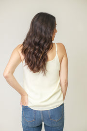 Back view of woman wearing white scoop neck cami top