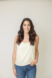 Classic white cami top with adjustable straps and lower in the back