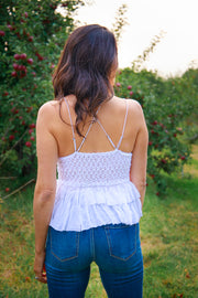 Back view of lace cami top with a flowy bottom